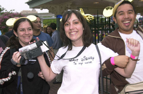 Wearing A T Shirt Exclaiming Walt Disney Is My Hero An Enthusiastic Guest Celebrates Coming Through The Turnstyle Arrving At Disneyland As Soon